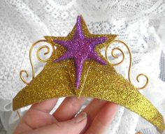 This Twilight Sparkle inspired crown is made from gold glitter foam and lined with ivory felt. The felt lining of the gold crown is cream unless