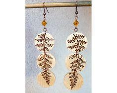 Wood burned dangle earringspyrography minimalist wood earringsslice wood eco jewelryglass bead wood earrings floral earringsBoho jewelry (26.75 EUR) by SorrisoDesign