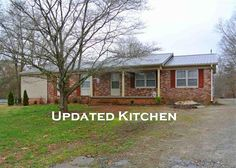 This cute brick ranch in Liberty is ready for new owners!