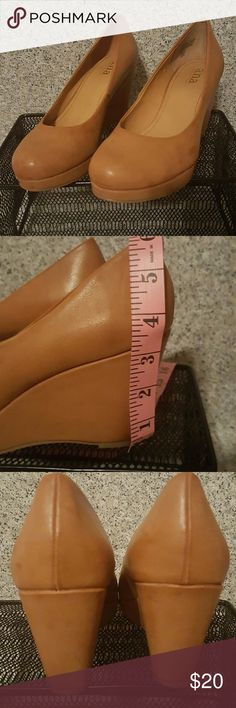 A.N.A. wedge heels size 8 Beautiful caramel color (tan) wedges. Excellent used condition, still in box. Awesome wedges...worn once, unfortunately a lil to large for me.  Comes from a smoke free home. Reasonable offers welcomed! a.n.a Shoes Wedges