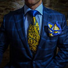 The Conservative Follow, The Bold Lead! Check out this Sebastian Cruz Couture Yellow and White Flower Print with Blue Signature Border Pocket Square. 100% handmade in the U.S. Be Bold!