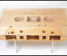This functional coffee table shaped like a giant cassette tape made of reclaimed maple and walnut wood with a protective top by Jeff Skierka Designs will soon be available.