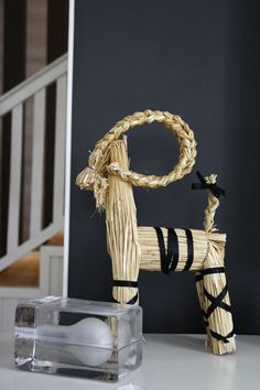Christmas goat with black ribbons.