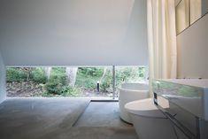 Concrete floor step down for bath + low window.