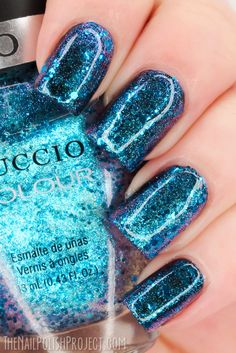Cuccio Illumination one coat over black here to show the duochrome turquoise-purple finish, as well as the blue glitters.