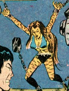 Tigra is chained to the wall.