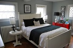 love this red dresser... thinking I am going to get a navy throw for my bed like this too.