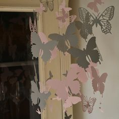 New! Because of the grey matching my grey wall I took pictures of this butterfly mobile on my small white wall 😉