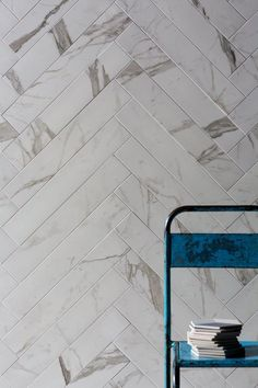 Mimica Statuario Gloss Porcelain is an excellent faux marble. All the beauty of marble tiles but the practicality of porcelain. Laid here in a herringbone pattern.