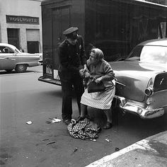 U.S. Helping a troubled old woman, 1950s // Vivian Maier, street photographer (1926 - 2009). She took hundreds of thousends of photographs in her lifetime, never shared them with anyone.