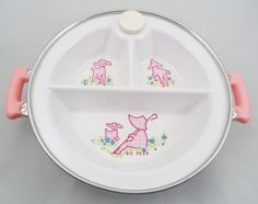 Excello Baby Divided Dish, Bo Peep Warming Dish, 3 Divided Sections on Rubber and Metal Base. Toys Not Included. Measures 10 1/4 wide handle to handle. 1 1/2 deep sections. Cute little Bo Beep design with Lambs and Flowers. Metal and Plastic baby dish with cute pink graphics. I