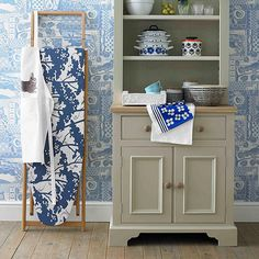 IRONING-BOARD-COVER-COUNTRY-HOMES-AND-INTERIORS.jpg 550×550 pixels (love the color of the cupboard)