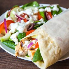 Chicken Souvlaki with Tzatziki. Chicken Souvlaki with Homemade Tzatziki - Light and spicy chicken wraps with a creamy cucumber dressing. Spicy Chicken Wrap, Chicken Wraps, Tortilla Wraps, Cucumber Dressing, Chicken Souvlaki, Tacos, Homemade Tzatziki, Creamy Cucumbers, Main Dishes