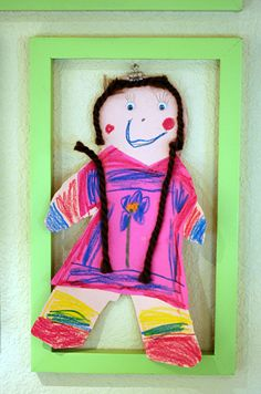 kids art display... frame & clip allows for variety of sizes and dimension but creates continuity with frames