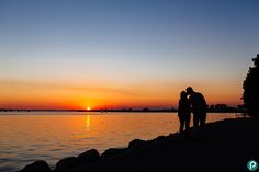 Creative and romantic couple portrait photography on a pre wedding shoot in Poole, Dorset | Sunset over Poole Harbour