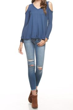 A dark denim blue v-neck waffle top with a cold shoulder. The a-line cut gives this top a flattering fit. Wear with a floppy hat and some platforms for a 70's inspired look!   Denim Cold Shoulder Top by Final Touch. Clothing - Tops - Long Sleeve Kansas