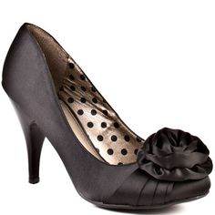 Blossom - Black  Bring springtime to winter in this gorgeous floral pump from Fergie. Blossom features a black satin upper with a beautiful fabric flower detail at the vamp. A low 3 1/2 inch black patent heel accents this style and will have you outshining every party guest.  $49.99