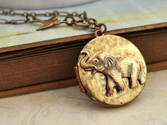 Best of Friends baby elephant vintage locket by plasticouture, $32.50 This is gorgeous i love Elephants wonderful animals..  :))