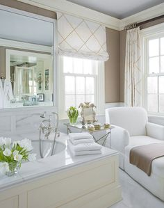 Emily Gilbert Photography: Stylish bathroom design with cappuccino paint color. Marble bath surround with oval bath ...