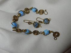 Spriraled spirals. Blue glass spiraled beads in antiqued brass spiraled links.  Bracelet and earrings  $29.95 USD