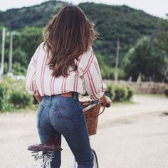 High waisted jeans, baggy button down shirt, long hair, bike with basket: be still my beating nostalgic heart!