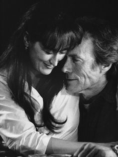 The Bridges of Madison County has one of my all time favorite scenes. She's in the car with her husband, he's in the truck in front of her car, she grabs the door handle, it's pouring, you want her to leave her husband and run away with this photographer... oh... #Eastwood #Streep
