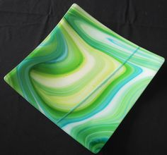"""Fuser's Reserve glass makes this piece one of a kind. Accented with an inset turquoise stripe. 12"""" square, kiln fired to fuse, then fired again to slump into usable platter."""