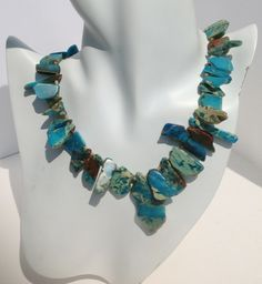 African Turquoise Slab Necklace This is a stuning and unique African Turquoise Necklace. Necklace is compose of irregular pieces of all natural Turquoise slab, Silver toggle clasp. Turquoise Necklace, Beaded Jewelry, Jewelry Making, African, Sterling Silver, Stone, Elegant, Natural, Unique