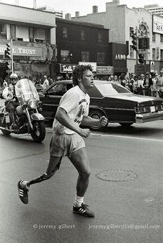 Terry Fox, during his Marathon of Hope, crosses Yonge Street at Bloor in Toronto, July 12, 1980. <