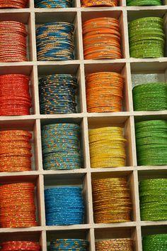 red, turquoise, orange, yellow, green bangles