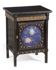 Herter Brothers, attributed  An Aesthetic Movement Ebonised Bedside Cabinet, circa 1880  inlaid with ivory and fruitwood, the channelled rectangular top above a stylised leaf and flower frieze and a circular panelled door inset with a cloisonné plaque decorated with exotic flowers and butterflies, on square supports  51.5cm wide, 41cm deep, 69cm high
