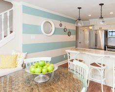 Beachy blue striped kitchen accent wall with porthole-eaque mirrors: http://www.completely-coastal.com/2015/08/hgtv-beach-flip-homes-decor-Joss-and-Main.html