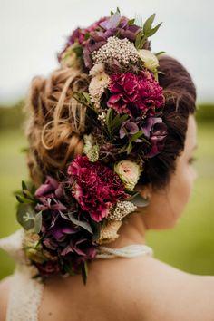 Elaborate wedding hairstyle using flowers. Photograph by Olga Hogan, Dublin.