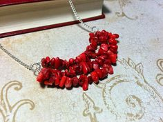 Be at the center of fashion this fall with the Samantha- Red Coral Natural Stone Chip Bib Necklace.