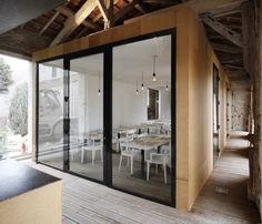 Oh, how I LOVE the renovation of an old barn!  Restaurant in Charroux, France.