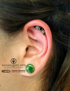 Katherine had us pierce her helix and she's off to a great start with her healing.  She chose this lovely threaded cluster from anatometal.  Peridot and black CZ gems handset in implant grade titanium. Thank you, Katherine! We have more threaded clusters in stock, so swing by and treat yourself to something fancy.