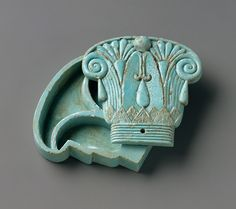 Cosmetic Box In The Shape Of A Composite Capital  --  Egypt  --  664-300 BCE  --  No further reference provided.
