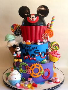 - All decorations edible art including ice cream, cupcakes, candy, hat, and Mickey. Fun cake to make for a special little boy's first birthday.