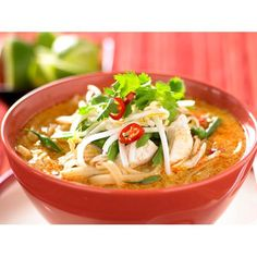 This chicken laksa by Everyday Food is a classic example of this warming soup. Filled with spice, creamy coconut milk, chunks of tender chicken and silky rice noodles, it's a meal in a bowl.
