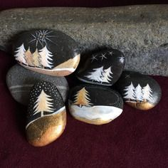 Trees painting on black rocks with pretty gold metallic paint and white. Fancy looking painted rocks! Trees painting on black rocks with pretty gold metallic paint and white. Fancy looking painted rocks! Stone Crafts, Rock Crafts, Fun Crafts, Christmas Crafts, Christmas Ideas, Christmas Decorations, Christmas Scenes, Easy Diy Crafts, Christmas Ornaments