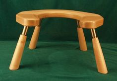 """Knock Down Birthing Stools: Handmade in maple in 10"""" or 12"""" height, accompanied with a carrying bag. This stool is also available with two sets of legs: One putting the seat at 10"""" for a deep squat in the 2nd stage of labor and the other set for putting the stool at 12"""" for those taller clients needing a higher seat. The birthing stool is part of a midwifery tool kit from an artist in Ontario. This site also has fetoscopes and other beautifully crafted midwifery tools."""