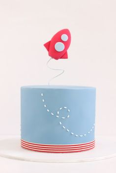 Rocket ship birthday cake. Would be perfect dark blue and stars for Caleb's first birthday. Love the flying rocket!