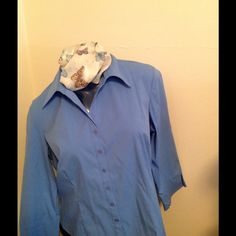 Light Blue Blouse Light blue blouse. It is a stretch top. Tops Button Down Shirts