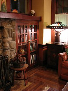 Craftsman look with built-in book shelves with glass doors.