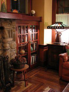 built-in book shelves with glass doors.