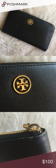 Tory Burch Robinson Wallet Gently used for about a year...it is in very good used condition. Some wear on the corners, I took a photo of the area that has the most wear (third photo). Tory Burch Bags Wallets