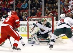 Minnesota Wild goalie Devan Dubnyk (40) makes a save during the second period against the Detroit Red Wings at Joe Louis Arena.  #9223248