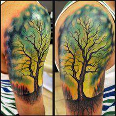Aurora Borealis tattoo muecke ink muecke art color tattoo tree sillouette tattoo ink arm sleeve roots trees forest sky tattoo muecke aurora bora | Tattoo.com