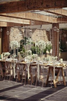 Crystal & transparent wedding theme with bead curtain, sequins, transparent chairs & candelabra.  Styling www.inspirehire.co.uk Photography www.emmasolley.co.uk  Venue www.lowergrenofen.co.uk