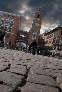 Ferrara, Italy, suggestiva questa immagine, ripresa a suolo rasente  dal selciato di Piazza Duomo  e inquadra il campanile a lato del ex Palazzo della Regione.
